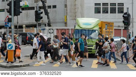 Tsuen Wan, Hong Kong 03 June 2020: People cross the road in city