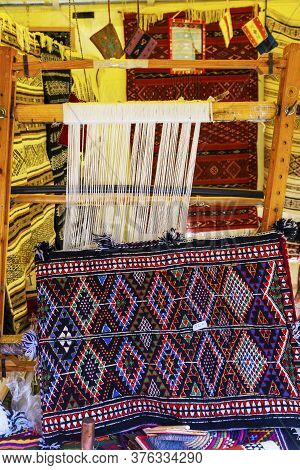 A Traditional Rug Being Woven On A Carpet Vertical Loom, Showing Wool Pile Under Tension, Foundation