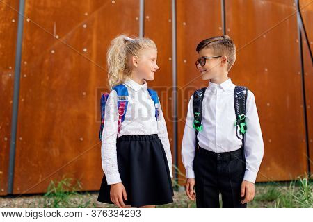 Two Schoolchildren Are Together, Little Schoolchildren, Little Schoolchildren Are Returning From Sch