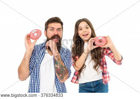 Bakery Shop. Fathers Day. Sweet Tooth. Girl Child And Dad Hold Glazed Donuts. Cheerful Family. Sweet