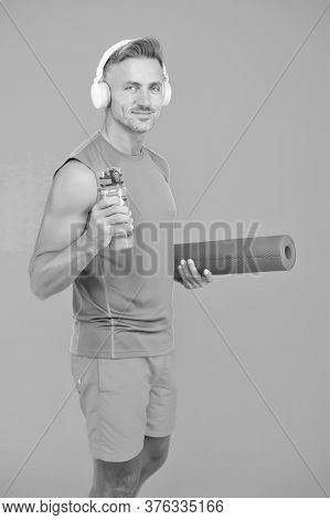 Your Muscles Are Thirsty. Sportsman Hold Water Bottle. Yoga Coach. Fitness Trainer. Feeling Thirst I