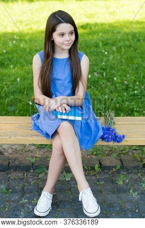 Summer Fun Has Begun. Little Child Sit On Park Bench. Small Girl Relax With Book On Summer Day. Summ