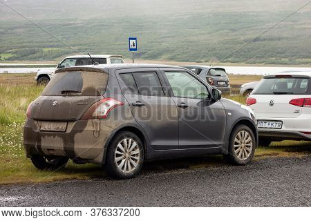Iceland - July 3, 2014: Extremely Dirty Suzuki Swift 4x4 Small Car On An Iceland Road After Driving