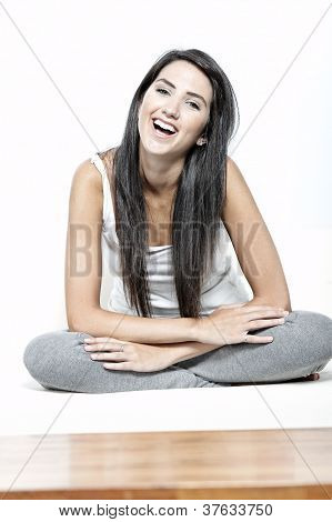 Young Woman Sat On White Sofa