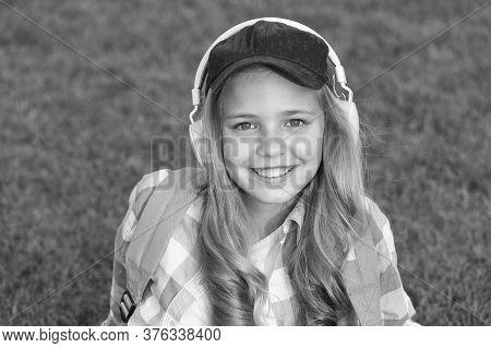Enjoy Every Moment. Listen Music While Relaxing Outdoors. Kid Girl Enjoy Music Green Grass Meadow. P
