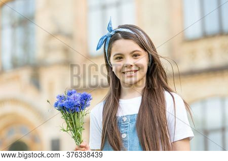 Shes Cool, Ooh Girl. Happy Girl Hold Flowers Outdoors. Little Girl With Long Hairstyle. Hair Salon.