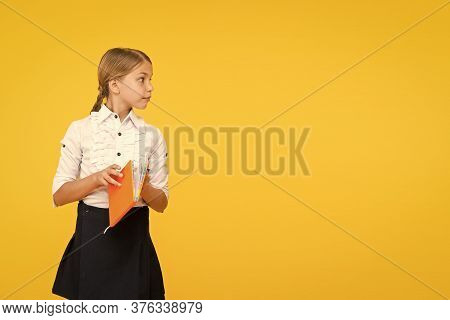 A Moments Of Reading The Best. Adorable Little Girl Holding Reading Book On Yellow Background. Cute