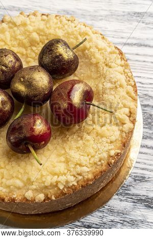 Tasty Cake With Cherry On Wooden Background Close-up. Healthy Homemade Sweet Dessert