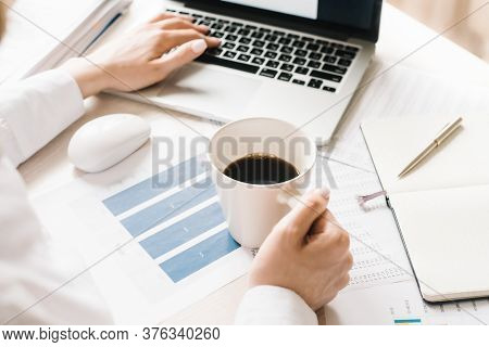 Woman Is Typing On Keyboard Of Laptop Or Notebook, Check Electronic Mail, Get Some Information For S