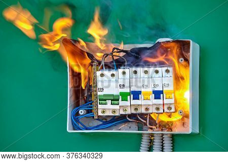 A Short Circuit Caused An Electric Fire. Faulty Wires Led To Overload Of The Electrical Network And