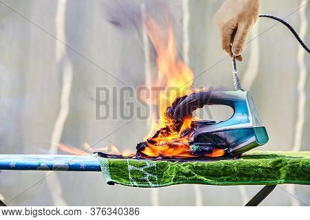Burned Iron For Ironing Clothes, Which Was Connected To The Power Of The Forgotten. An Overheated Ho