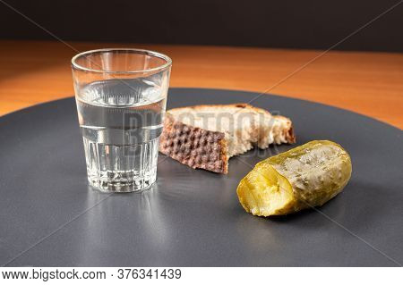 Glass With Vodka, Sake, Pickles And Bread. Snack And Alcohol.
