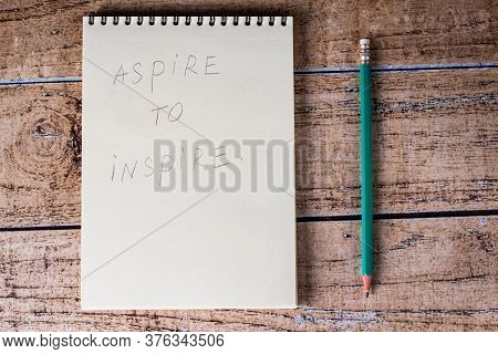 Notebook And Green Pencil, Aspire To Inspire. Motivational Phrases And Quotations, Success In Life A