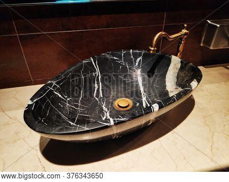 Black Marble Sink And Faucet In Bathroom, Washroom, Toilet.
