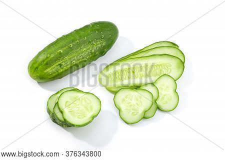 Organic Cucumber And Slices Isolated On White Background. Cucumis Sativus