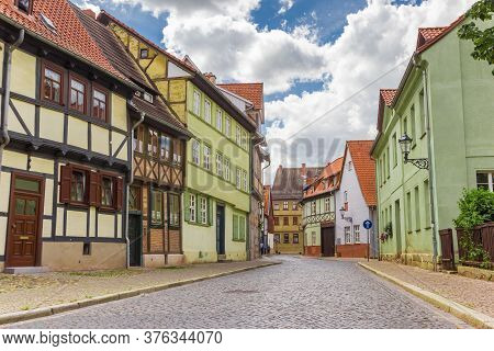 Street With Colorful Half Timbered Houses In The Center Of Quedlinburg, Germany