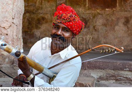 Jodhpur, Rajasthan, India, 2020. Closeup Of Traditional Rajasthani Sarangi Player In His Traditional