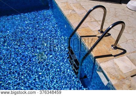 Handrail On Pool. Swimming Pool With Stair At Tropical Resort. Pool Handrails View. Water Swimming P