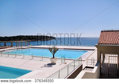 Swimming Pools Of Luxury Holiday Hotel, Amazing Nature View Landscape Sea. Relax Near Two Swimming P