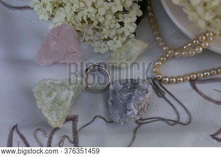 On A White Napkin Are Natural Semiprecious Stones - Rose Quartz, Aquamarine, Prenite, Celestine. Nea