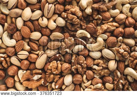 Different Types Of Nuts, Nut Mix Of Almonds, Hazelnuts, Cashews, Peanuts Texture Background. Close U