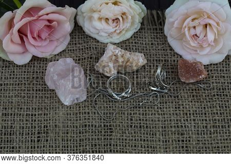 On Jute Fabric Are Flowers Of Roses And Semiprecious Stones - Rose Quartz, Dolomite, Halite. Nearby