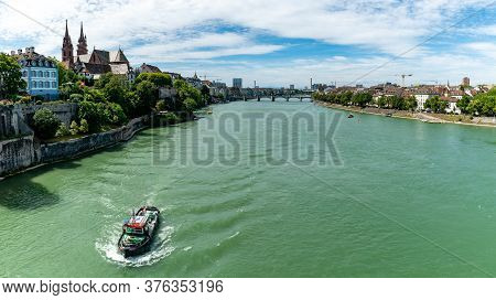 Basel, Bl / Switzerland - 8 July 2020: A River Tug Boat Travelling Upstream On The Rhine River In Th