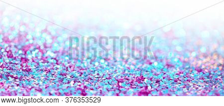 Ultraviolet glitter shine dots confetti. Abstract light blur blink sparkle defocus horizontal backgound.
