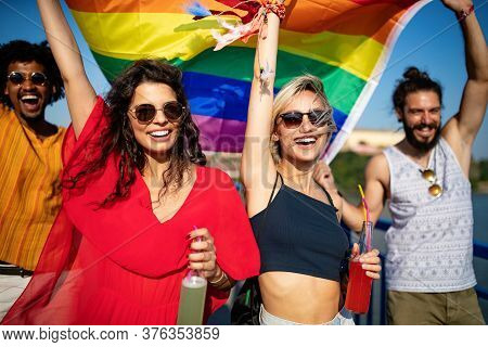 Happy Group Of People Hanging Out In The City Waving Lgbt With Pride Flag