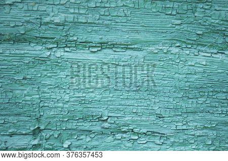 Many Layers Of Peeling Paint. Grainy Painted Green Surface, Beautiful Green Background