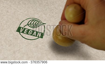 Vegan Stamp And Stamping Hand. Life Style, Ecology, Bio, Organic Food, Vegetarian And Natural Health