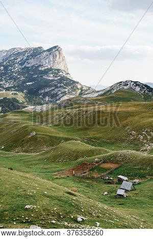 An Empty Sheepfold In The Green Hills Among The Mountains Of Montenegro, In The National Park Durmit