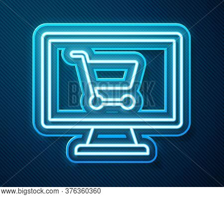 Glowing Neon Line Shopping Cart On Screen Computer Icon Isolated On Blue Background. Concept E-comme