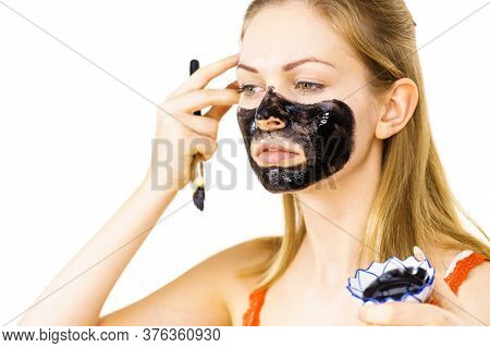 Woman Being Apply Black Mask To Skin Face