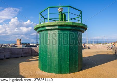 Marina Di Pisa, Italy - August 14, 2019: A Green Lighthouse At The Port Of Marina Di Pisa, Tuscany,