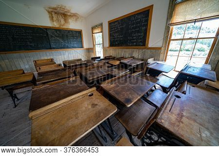 Bannack, Montana - June 29, 2020: Inside The Old Restored Schoolhouse, With Desks And A Chalkboard I