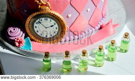 Stylized Cake For The Holiday In The Style Of Alice In Wonderland With Jars With Potion Next To