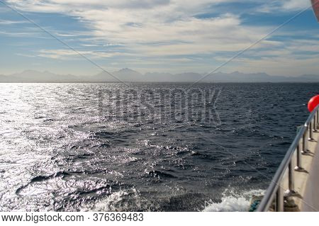 View From Yacht To Sea Horizon. Blue Waves Of Red Sea. Sea Waves Reflect Sunlight. View From Board O