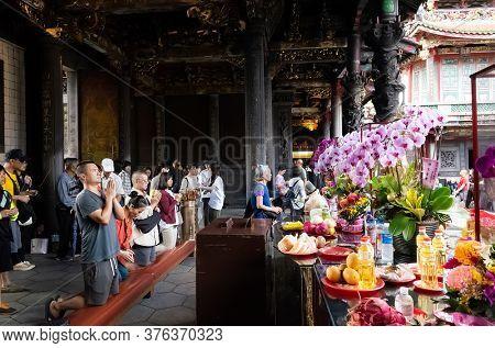 Taipei, Taiwan - October 20th, 2019: people praying in Lungshan temple at Taipei, Taiwan