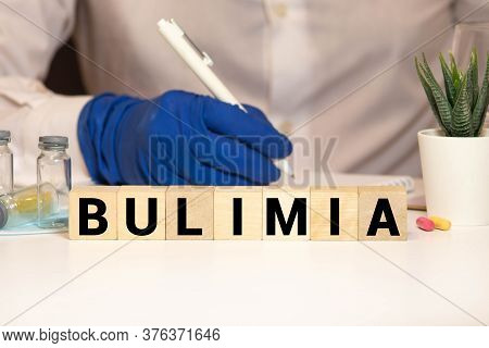 Bulimia Word From Wooden Blocks On Desk