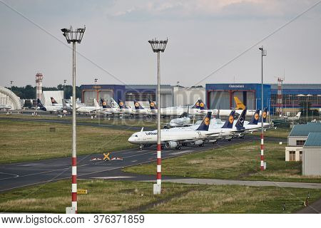 Budapest, Hungary - July 4, 2020: Many Aircraft of Lufthansa parked at airport. Airlines to find parking place to store unused airplanes during travel restrictions for Covid-19 coronavirus pandemic