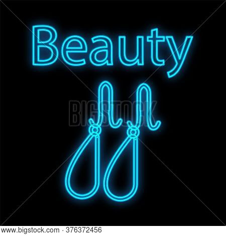 Blue Neon Earrings For Earlobes On A Black Background. Accessories For Girls And Men Emphasize The S