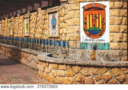 Polop De Marina, Costa Blanca, Spain - 3 Otober 2019: Water Fountains With A Flag Emblem Of Polop De
