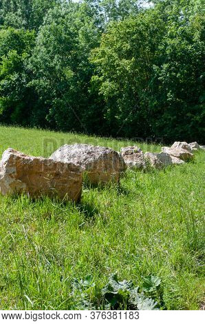 Large Jurassic Limestone Boulders In A Meadow Near Forest Edge In Swabian Alb