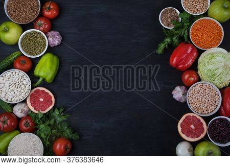 Legumes, Beans, Mung Bean, Cereals, Vegetables, Fruits, Greens On A Black Background. Vegetarian Foo
