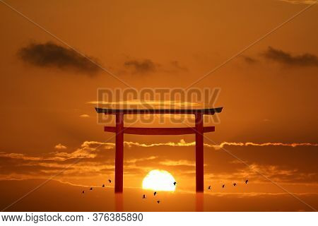 Torii Sunset Orange Cloud On Sky And Birds Flying On Sea