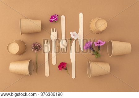 Zero Waste Plastic Free Concept Disposable Paper Cups With Wooden Forks And Knives On Beige Backgrou
