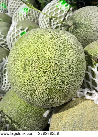 Closed Up Fresh Melon Netting Texture In The Fruit Market.