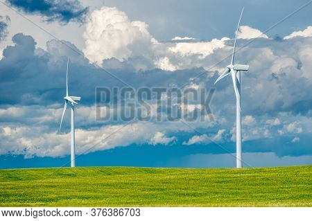 Storm Clouds Over Wind Turbines In A Wheat Field Outside Swift Current, Saskatchewan, Canada
