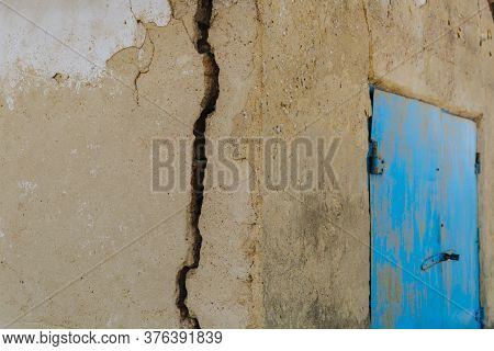 A Large Dangerous Crack In The Wall Of The House. Destroying The House, The Alarm State. Closeup, Cr